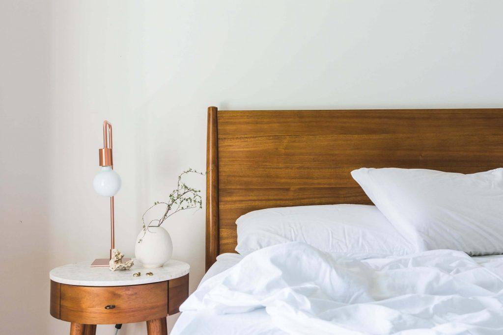 white minimalist natural wood bedroom