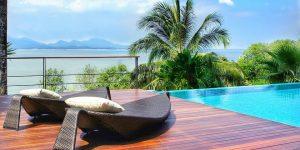 luxury backyard pool with loungers
